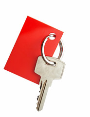 Key with blank red label for your text isolated on white backgro