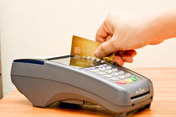 Close up Payment machine on during using Credit card from custom