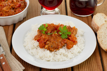 meatballs with sauce, parsley and boiled rice