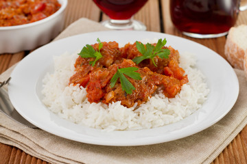 meatballs with boiled rice on the white plate