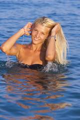 Blonde in the water waving hair