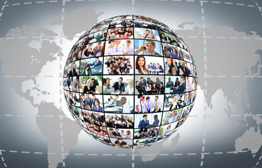 A globe with many different business people