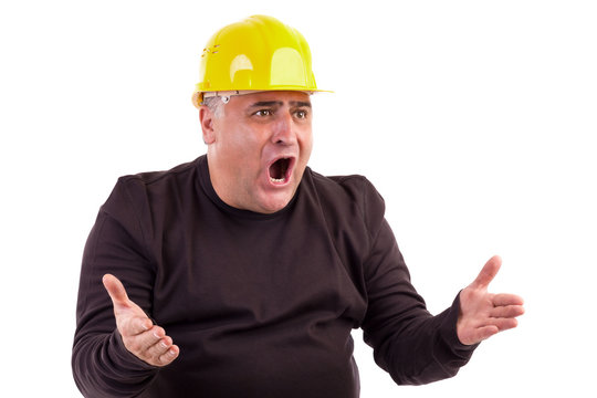Angry construction worker looking at something