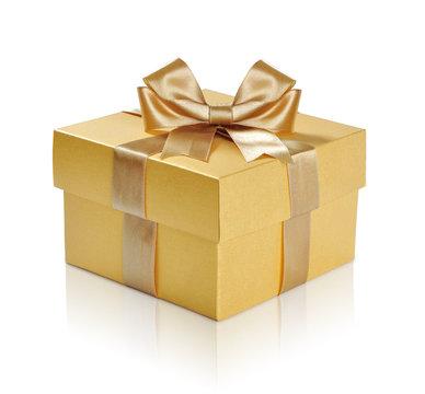 Golden gift box with golden ribbon over white