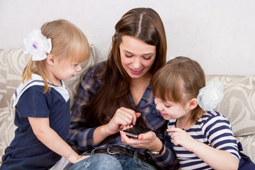 The three sisters with smartphones