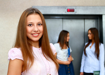 Three young women near the elevator