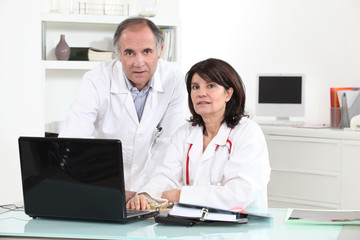 two doctors in their office