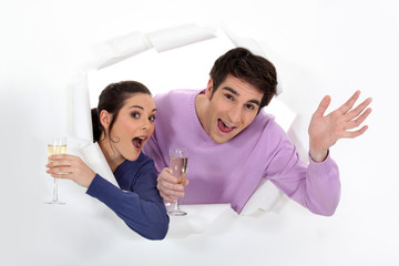 Happy couple holding champagne flutes