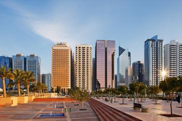 A warm sun illuminates the Abu Dhabi Skyline