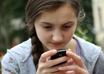 Girl playing on mobile phone