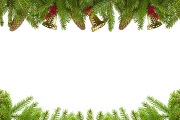 Spruce branches with cones and bells on  a white background
