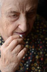 senior woman taking pill
