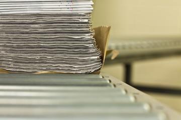 Newspaper stack on a conveyor