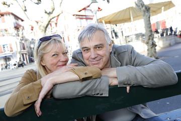 Senior couple sitting on a public bench