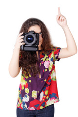 Cute curly girl with camera isolated