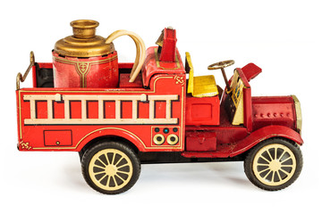 Vintage tin fire truck toy isolated on white