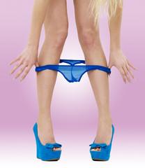 A woman pulls off her panties