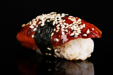 delicious sushi isolated on black