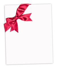 big red bow on paper sheet