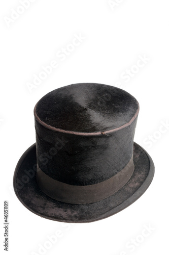 ca83d22eb3876 Old black high hat isolated on white background.