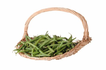 green beans in a straw basket, isolated on white