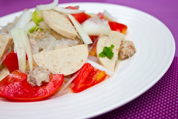 Thai dressed spicy salad wih pork, tomatoes and cellophane noodl