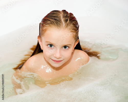 Little girl is taking a bath stock photo and royalty Tiny girl teen
