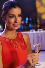 Elegant woman with champagne flute