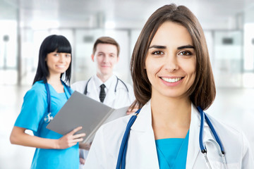 Female doctor standing in frount of his team