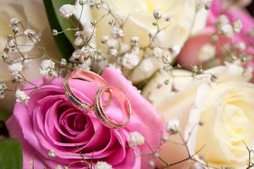 Gold wedding rings on flower . Decorating the wedding ceremony.