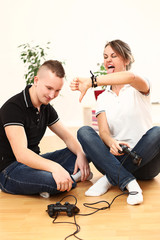 Young couple emotionally playing video games