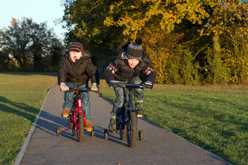 boys riding their bikes in a country park
