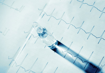 Ampule, casts a shadow on the ECG. Medical concept.
