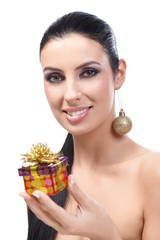 Beautiful woman with christmas box