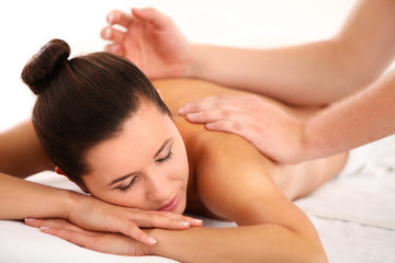 Young woman getting relaxing spa massage