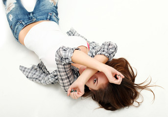 Attractive sensual woman lying on a white floor