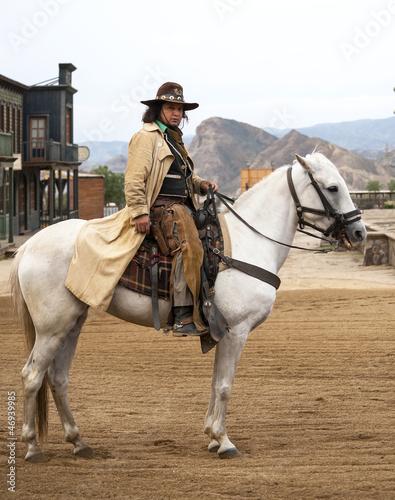 Wall mural Cowboy Riding his horse at Mini Hollywood, Almeria, Spain