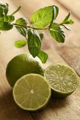 Fresh sliced lime with mint on a wooden surface