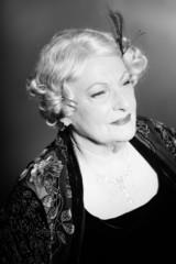 Senior woman glamour vintage style. Black and white studio shot.