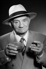 Senior vintage man wearing hat. Black and white shot. Gangster.