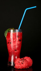 A glass of fresh watermelon juice isolated on black