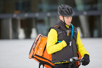 Young Courier Delivery Man Using Walkie-Talkie