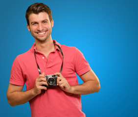 Portrait of a man holding camera