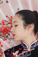 Serene woman wearing traditional Asian clothing