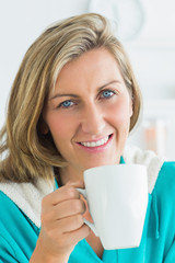 Woman holding cup with hot drink
