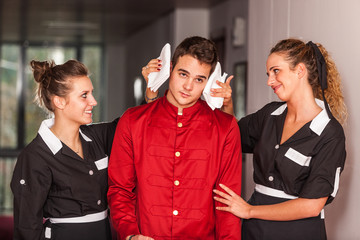 Chambermaids Helping Bellboy