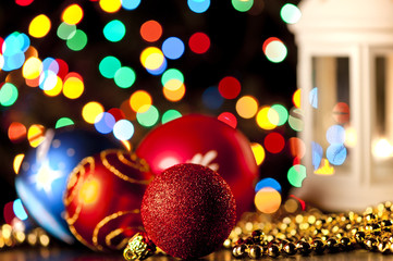 Christmas balls on the background of blurred lights garlands