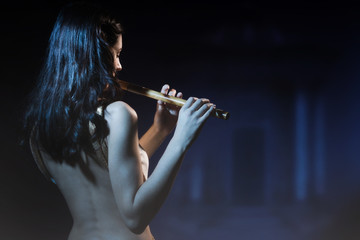 Sensuality brunette plays a wooden flute