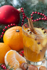 Black tea on christmas day with mandarin and nut