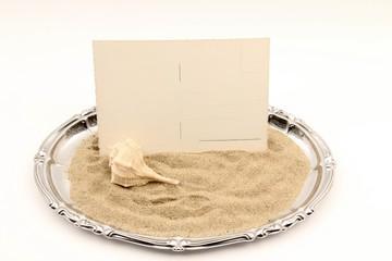 postcard and shell on sand